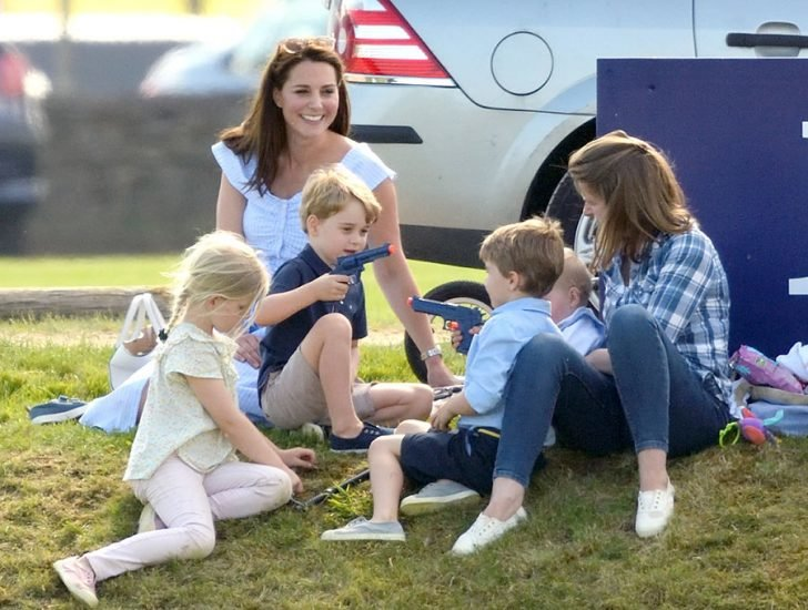 Kate and Lady Laura's children were photographed playing on the ground with their mothers smiling profoundly.